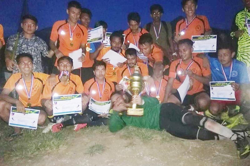 Players of Youth Club Bhimad pose for a group photo after winning District League Football Tournament, in Tanahun , on Thursday, August 29, 2019. Photo: THT