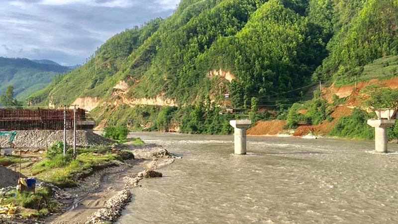 A view of under-construction bridge over Trishuli River, in Dhading district, on August 17, 2019. The motorable bridge will connect Keurini in Belkotgadhi Municipality-5 of Nuwakot district with Phosretar in Galchhi Rural Municipality-1 of Dhading district. Photo: Keshav Adhikari/THT