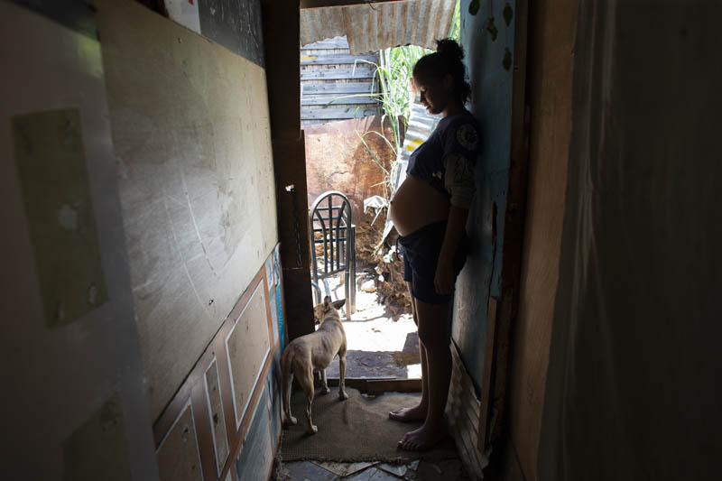 14-year-old Rosibeth Vargas, who is seven months pregnant, stands inside her home where she lives with her parents, 18-year-old sister and nephew, in the Tablitas area of the Caucaguita neighborhood on the outskirts of Caracas, Venezuela, August 5, 2019. Vargas said her school allows student mothers to bring their children to class, but that she dropped out after being bullied. Photo: AP