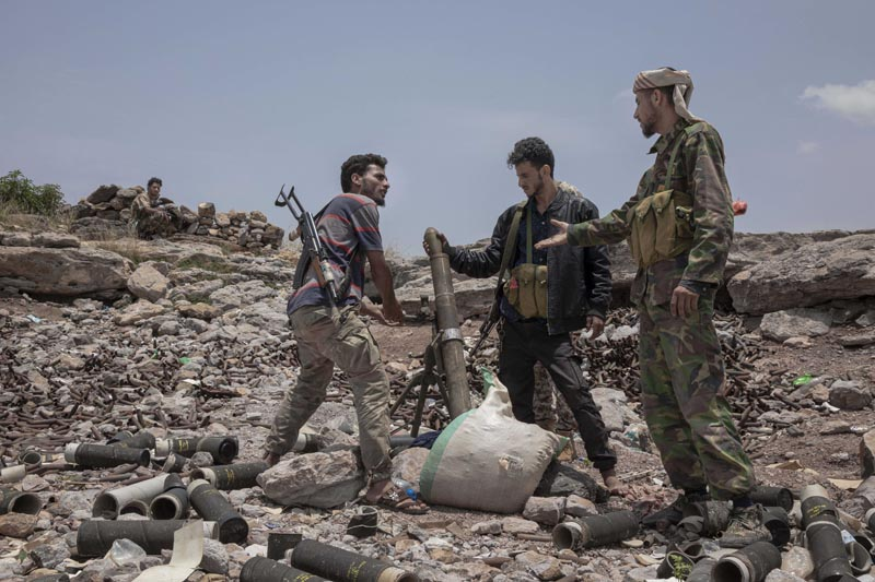 FILE - In this Monday, August 5, 2019, file photo, fighters from a militia known as the Security Belt, that is funded and armed by the United Arab Emirates, discuss launching a mortar towards Houthi rebels, in an area called Moreys, on the frontline in Yemen's Dhale province. Photo: AP
