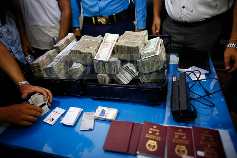 Forging ATM cards and millions of rupees along with other documents are displayed to the media after Five Chinese hackers were arrested for stealing millions of rupees from various ATM booths inside the Police Station in Kathmandu on Sunday. Photo: Skanda Gautam/ THT