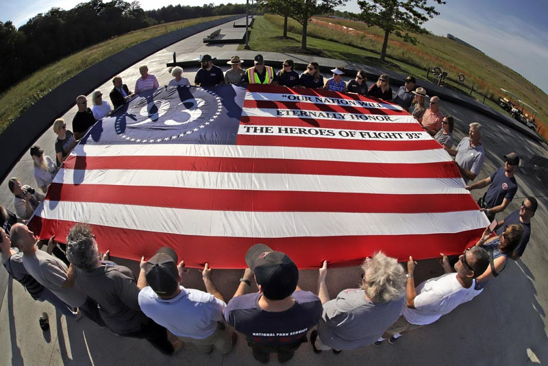 Visitors to the Flight 93 National Memorial in Shanksville, Pennsylvania, participate in a sunset memorial service on Tuesday, September 10, 2019, as the nation prepares to mark the 18th anniversary of the September 11, 2001 attacks. Photo: AP