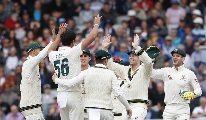 Australia's Mitchell Starc, without cap, celebrates with teammates after the dismissal of England's Jonny Bairstow during day four of the fourth Ashes Test cricket match between England and Australia at Old Trafford in Manchester, England, Saturday, Sept. 7, 2019. Photo: AP
