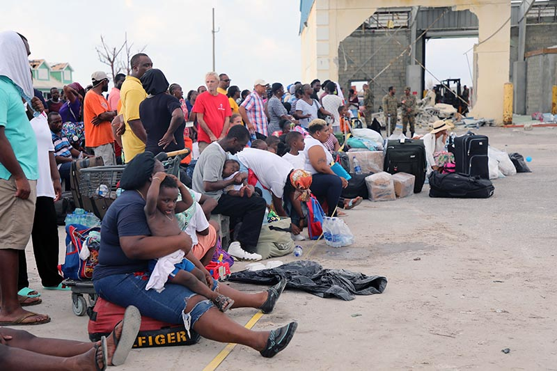 People wait in Marsh Harbour Port to be evacuated to Nassau, in Abaco, Bahamas, Friday on September 6, 2019. Photo: AP