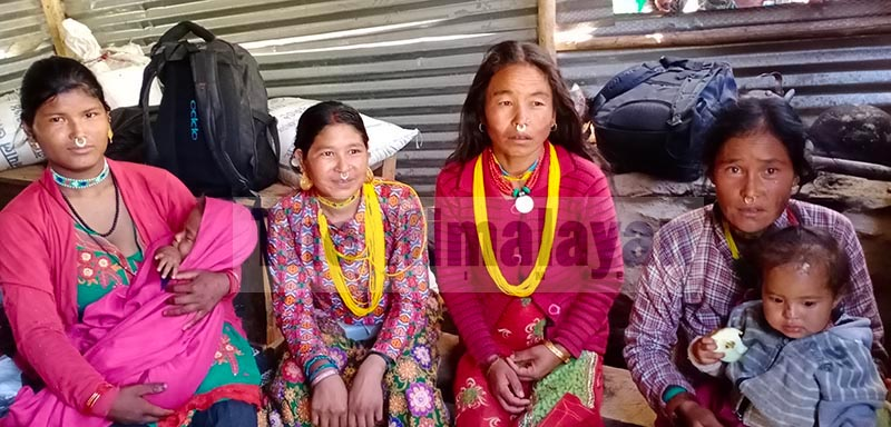 Women from Himali Rural Municipality, along with their children, sitting in front of Kawadi Food Depot, in Bajura after they did not get any rice there, on Wednesday, September 11, 2019. Photo: THT