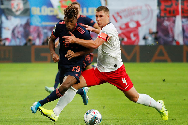 Bayern Munich's Kingsley Coman in action with RB Leipzig's Willi Orban. Photo: Reuters