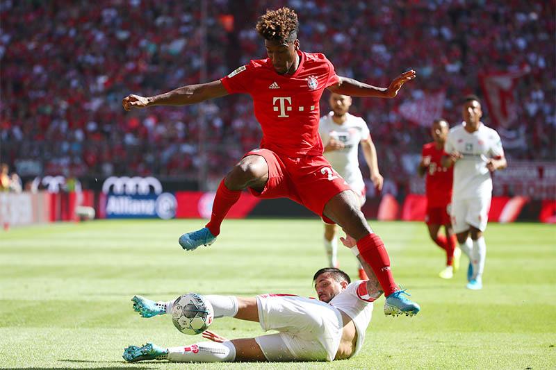 FSV Mainz 05's Danny Latza in action with Bayern Munich's Kingsley Coman. Photo: Reuters