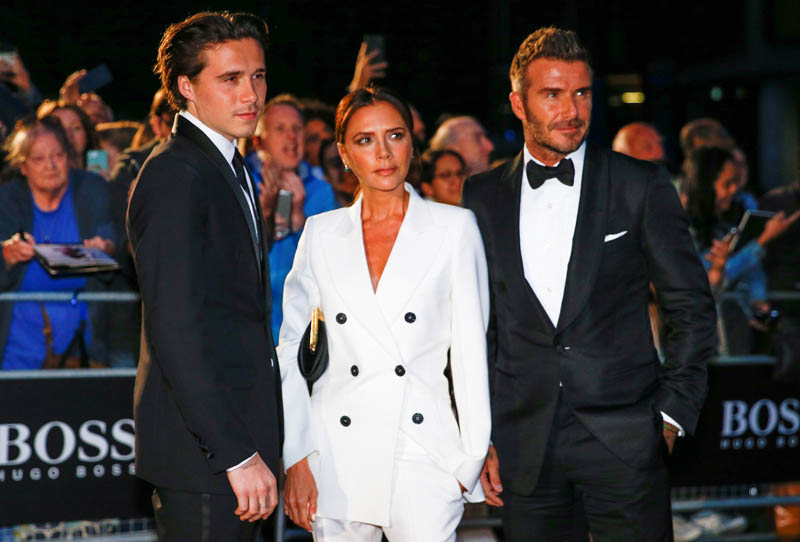 David Beckham, his wife Victoria Beckham and one of their sons, Brooklyn Beckham arrive to the GQ Men Of The Year Awards 2019 in London, Britain September 3, 2019. Photo: Reuters