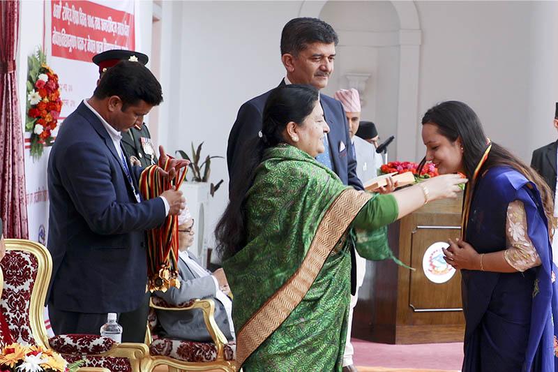 nnPresident Bidya Devi Bhandari confers the 'Nepal Bidya Bhushan' (B) on Sonyca Lamichhane on the occasion of the 40th National Education Day, at the President's Office, in Maharajgunj, on Sunday, September 08, 2019. Courtesy: President's Office
