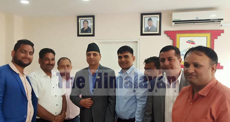 Airport Construction Struggle Committee members posing for photographs with the Minister of Culture, Tourism and Civil Aviation Yogesh Bhattarai after holding  discussion on upgrading Biratnagar Airport, in Kathmandu, on Sunday, September 9, 2019. Photo: THT