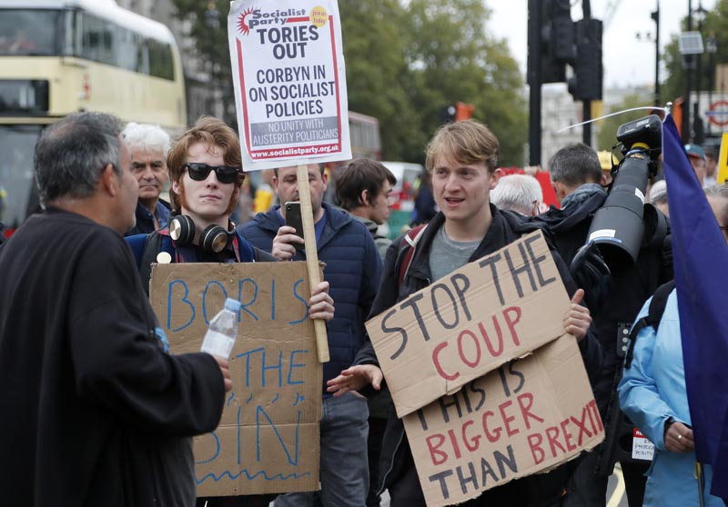 Protestors argue in parliament square in London, Monday, September 9, 2019. Photo: AP
