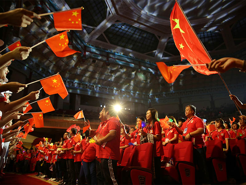Participants hold Chinese flags during a gala event organised by trade unions of Guangdong province, Hong Kong and Macau for Greater Bay Area workers to celebrate China's 70th founding anniversary on October 1, in Sun Yat-sen's Memorial Hall in Guangzhou, Guangdong province, China September 7, 2019. Photo: Reuters
