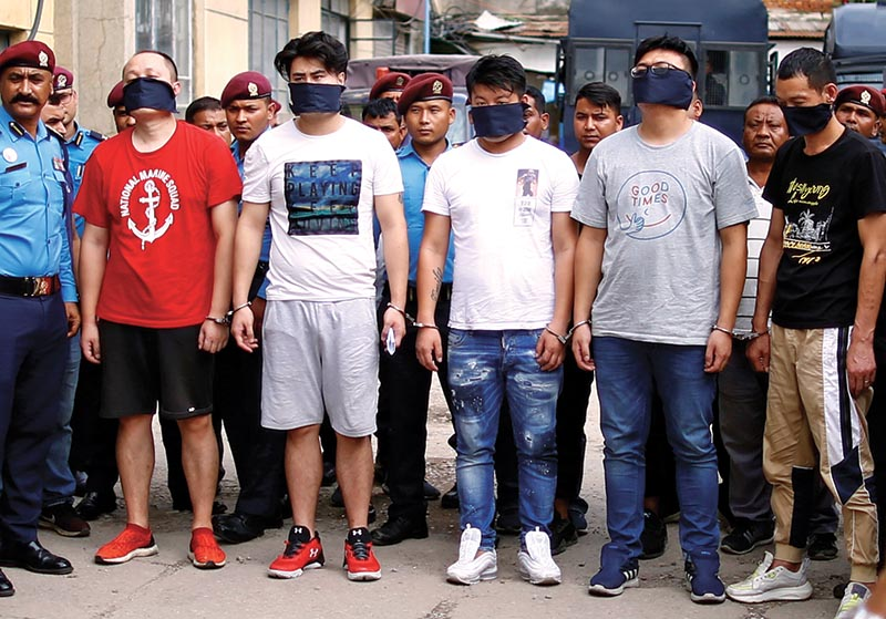 Five Chinese hackers who were arrested for stealing millions of rupees from various ATM booths are displayed to the media inside the Police Station in Kathmandu on Sunday. Photo: Skanda Gautam/ THT