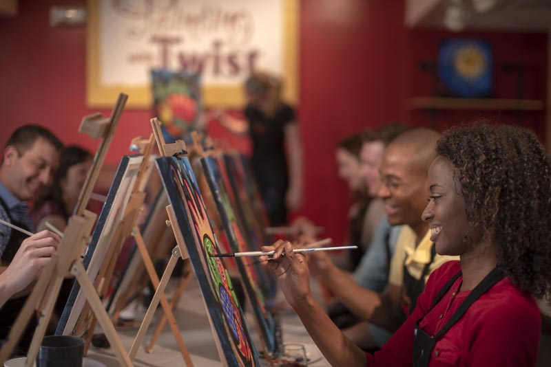 A group taking part in a Painting with a Twist event in Mandeville, Louisiana. In recent years, the interactive painting industry has become a global sensation. Around the world, adults can spend their nights out learning to paint in a relaxed, BYOB setting. Thousands of franchises exist to help us all unleash our inner creative. Photo: Painting with a Twist via AP