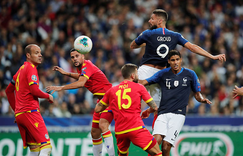 France's Olivier Giroud in action with Raphael Varane and Andorra's Marc Vales and Moises San Nicolas during the Euro 2020 Qualifier Group H match France between Andorra, at Stade De France, in Saint-Denis, France, on September 10, 2019. Photo: Reuters