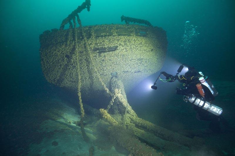 Diver John Scoles maneuvers around the wreckage of the schooners Peshtigo and St Andrews, lost in 1878 near Beaver Island in northern Lake Michigan, Aug 24, 2019. Photo: John Janzen via AP