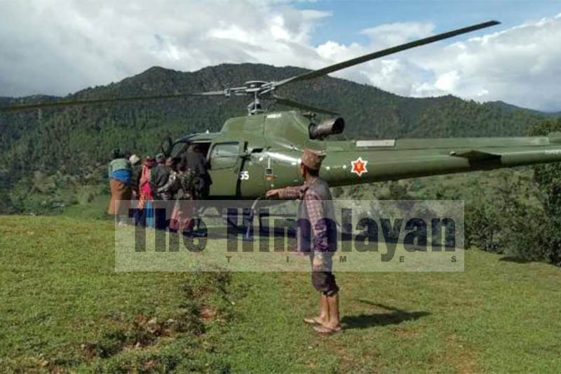 Locals helping a pregnant woman to board Nepali Army chopper in Jajarkot district, on Thursday, September 05, 2019. Photo: Dinesh Kumar Shrestha/THT