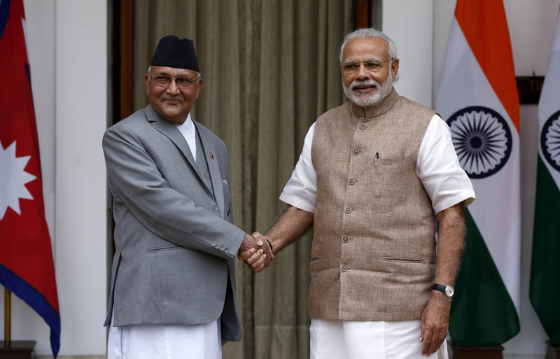 Nepal's Prime Minister Khadga Prasad Sharma Oli (L) shakes hands with his Indian counterpart Narendra Modi during a photo opportunity ahead of their meeting at Hyderabad House in New Delhi, India, February 20, 2016. Photo: Reuters/File
