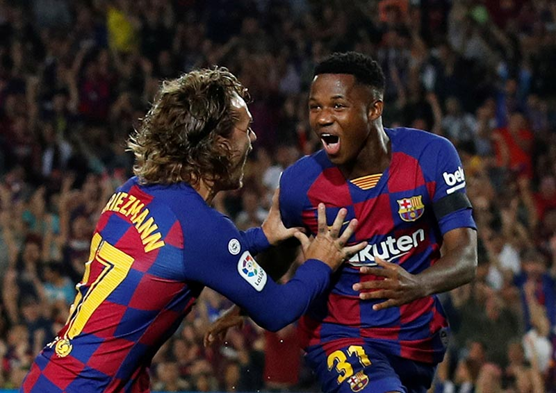 Barcelona's Anssumane Fati celebrates scoring their first goal with Antoine Griezmann during the La Liga Santander match between FC Barcelona and Valencia, at Camp Nou, in Barcelona, Spain, on September 14, 2019. Photo: Reuters
