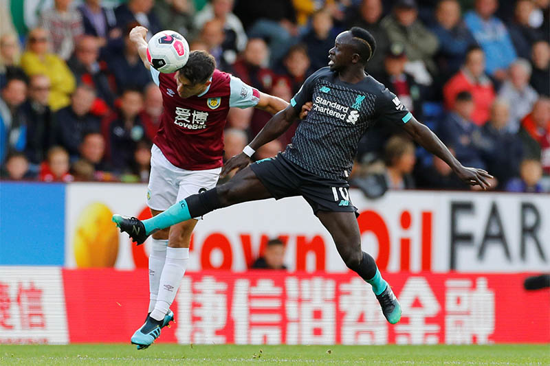Burnley's Matthew Lowton in action with Liverpool's Sadio Mane. Photo: Reuters