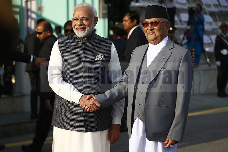 Prime Minister KP Sharma Oli shakes hand with his Indian counterpart Narendra Modi following the guard of honour in Kathmandu, on Friday, May 11, 2018. Photo: Skanda Gautam