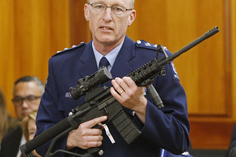 FILE - In this April 2, 2019, file photo, police acting superintendent Mike McIlraith shows New Zealand lawmakers in Wellington, an AR-15 style rifle similar to one of the weapons a gunman used to slaughter 51 people at two Christchurch mosques. Photo: AP