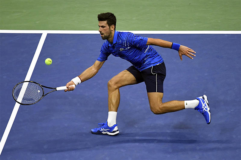 Novak Djokovic of Serbia hits to Denis Kudla of the United States in the third round on day five of the 2019 US Open tennis tournament at USTA Billie Jean King National Tennis Center. Mandatory Credit: Danielle Parhizkaran-USA TODAY Sports