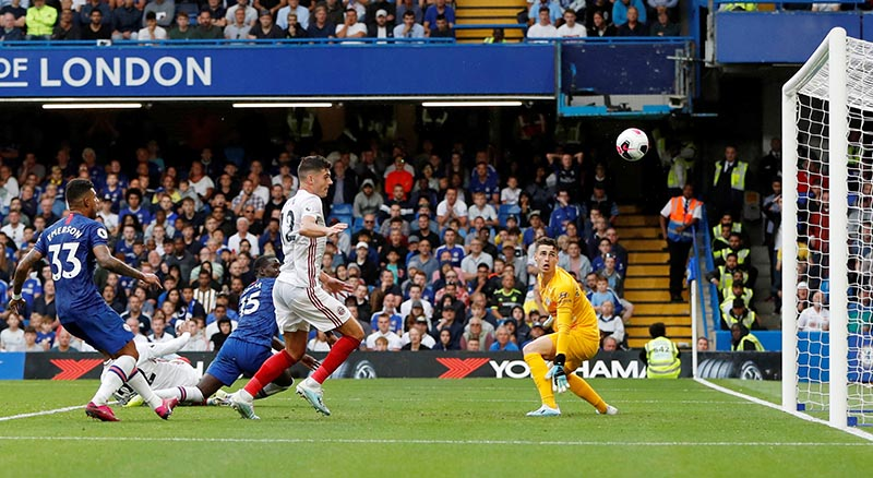 Chelsea's Kurt Zouma scores an own goal and the second for Sheffield United during the Premier League match between Chelsea and Sheffield United, at  Stamford Bridge, in London, Britain, on August 31, 2019. Photo: Action Images via Reuters