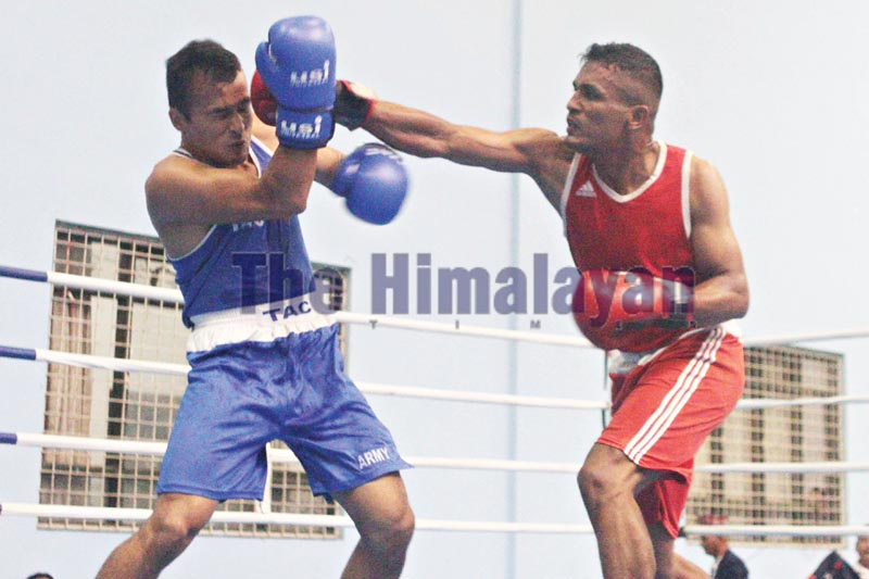 Manohar Basnet (right) of Karnali Province fights against Ganesh Pradhan of TAC during their menu0092s 81kg final bout of the selection tournament in Lalitpur on Tuesday, September 17, 2019. Photo: Udipt Singh Chhetry / THT