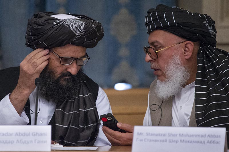 In this May 28, 2019 file photo, Mullah Abdul Ghani Baradar, the Taliban group's top political leader, left, and Sher Mohammad Abbas Stanikzai, the Taliban's chief negotiator, talk to each other during a meeting in Moscow, Russia. File Photo: AP