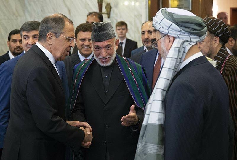 In this May 28, 2019 file photo, Former Afghan President Hamid Karzai, center, introduces the Taliban delegation to Russian Foreign Minister Sergey Lavrov, left, ahead of their meeting, in Moscow, Russia. File Photo: AP