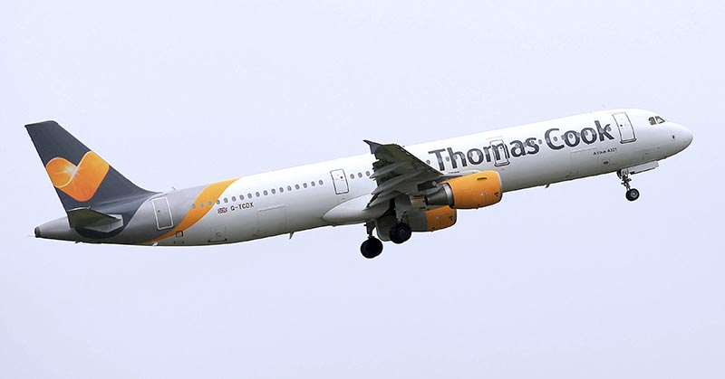 A Thomas Cook plane takes off from England. Veteran British tour operator Thomas Cook collapsed after failing to secure rescue funding, and travel bookings for its more than 600,000 global vacationers were canceled early Monday, Sept. 23, 2019. File Photo: AP