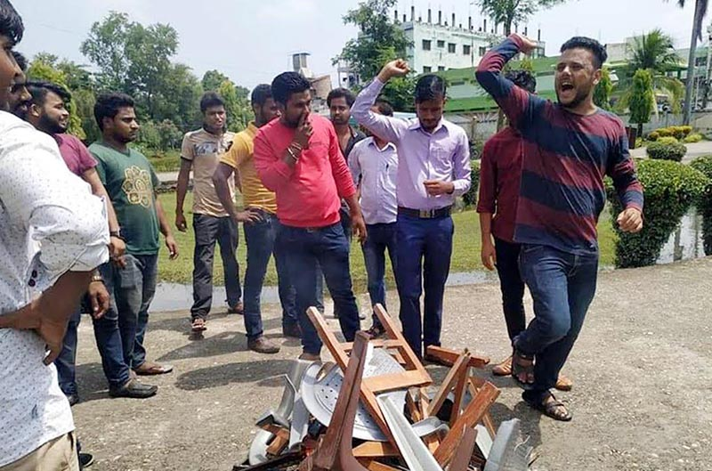 Students of Thakur Ram Multiple Campus about to set the furniture on fire as they protest against shifting of examination centre and irregular teaching-learning activities, in Birgunj, Parsa, on Tuesday, September 3, 2019. Photo: THT