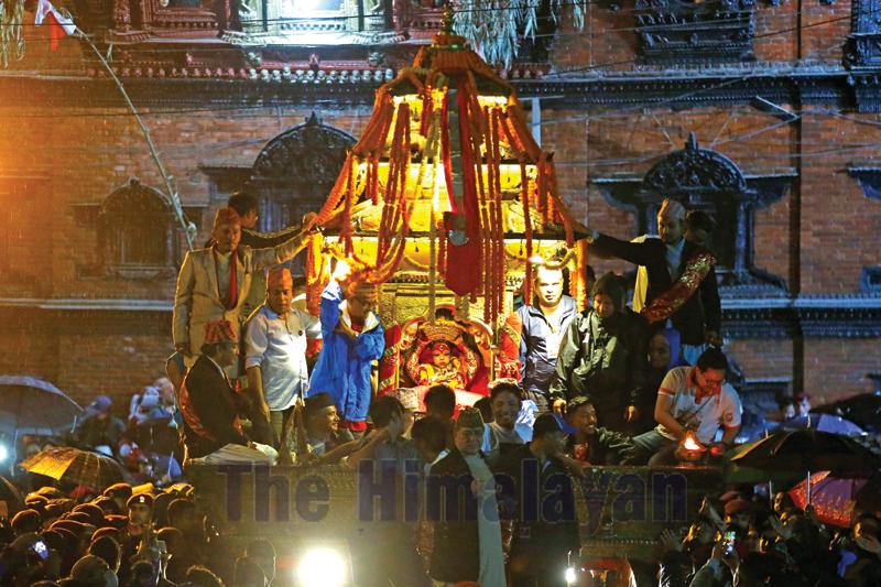 The Living Goddess 'Kumari' adjusts her crown inside the chariot on the last day of Indra Jatra festival, in Kathmandu, Nepal, on Tuesday, September 17, 2019. Photo: Skanda Gautam/THT