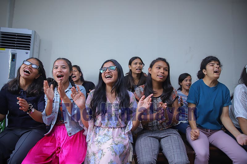 Students cheering performers at a programme to celebrate National Childrenu2019s Day at a local school, in Kathmandu, on Sunday. Childrenu2019s day this year was celebrated with the theme u2018Guarantee of Child Right: Base of Prosperous Nepal.u2019 Photo: Nishant S. Gurung / THT