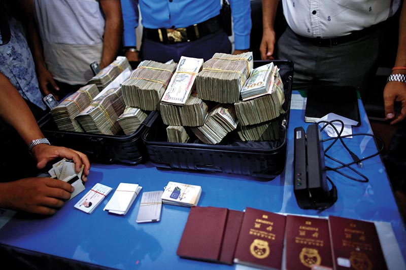 Forging ATM cards and millions of rupees along with other documents are displayed to the media after Five Chinese hackers were arrested for stealing millions of rupees from various ATM booths inside the Police Station in Kathmandu on Sunday. Photo/Skanda Gautam/ THT