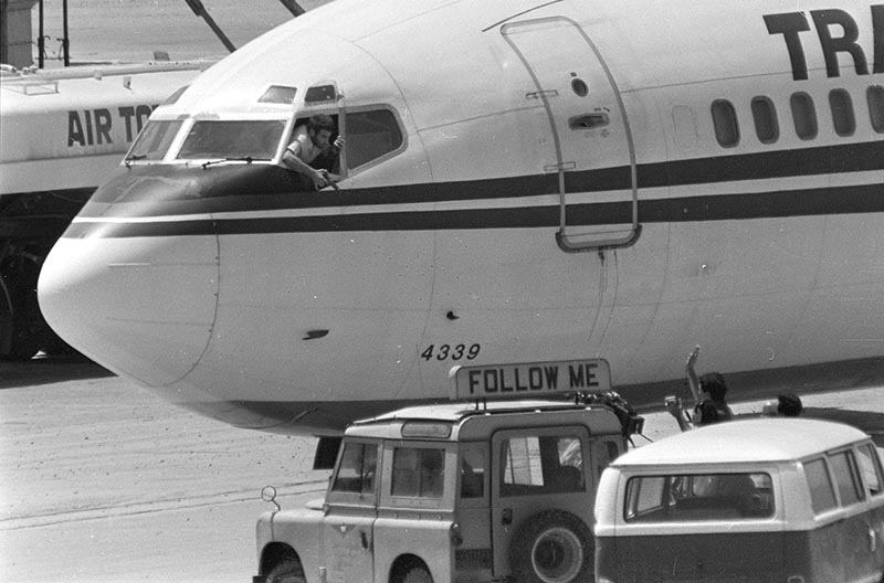 In this Wednesday, June 19, 1985 file photo, a hijacker points a weapon toward an ABC news media crew from the window of the cockpit of the Trans World Airlines jet as the American television crew approaches the jet for an interview at Beirut International Airport, Lebanon. File Photo: AP