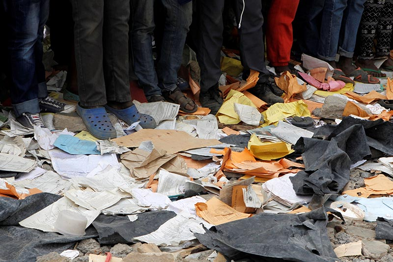 People stand near papers at the site of a collapsed school classroom, in Nairobi, Kenya, September 23, 2019. Photo: Reuters