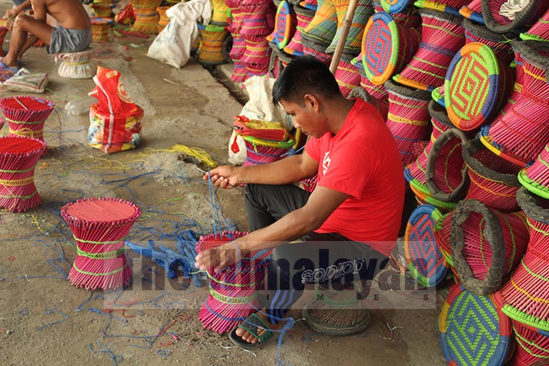 Prisoners at Tanahun prison preparing stools to sell during the festival of Dashain. Photo: Madan Wagle/THT