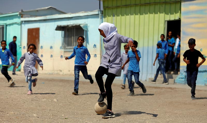 Palestinian students play soccer at their school in Jordan Valley in the Israeli-occupied West Bank September 11, 2019. Photo: Reuters
