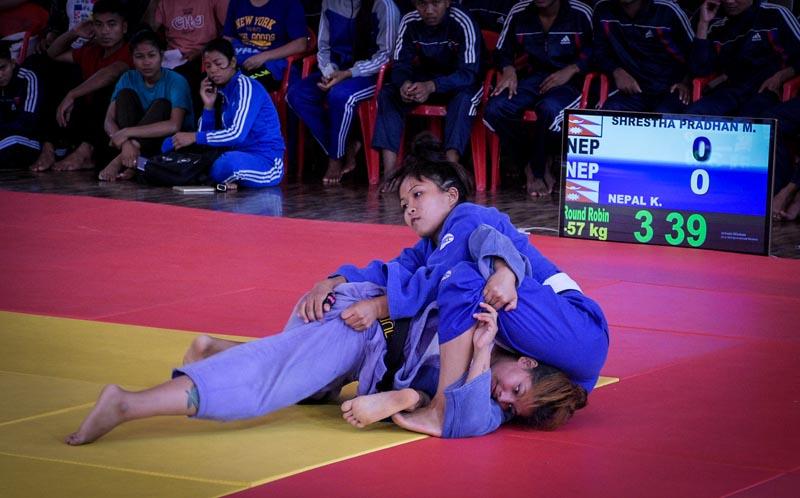 Manita Shrestha Pradhan (right) fights with Kabita Nepal during the selection tournament ahead of 13th South Asian Games in Kathmandu on Sunday, September2, 2019.Photo: Naresh Shrestha / THT
