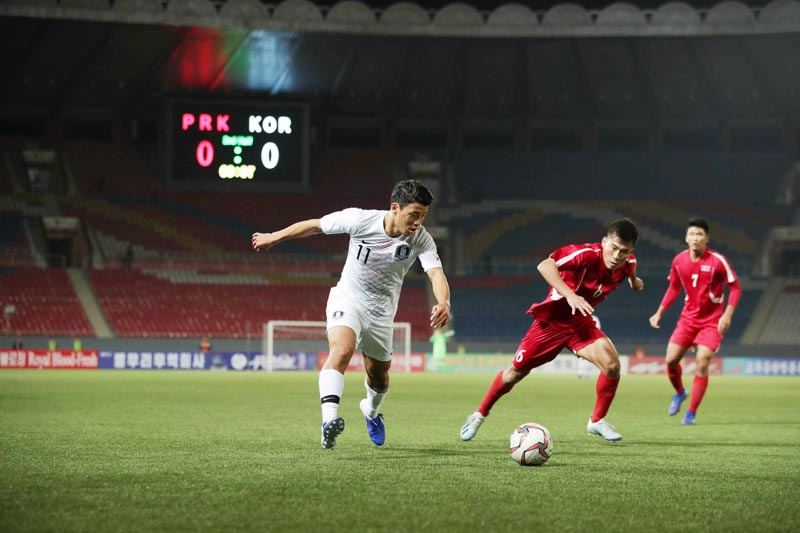 South Korea's Hwang Hee-chan in action during 2022 World Cup Qualifier Round 3 match between South Korea and North Korea at Kim II sung Stadium in Pyongyang, North Korea on Tuesday, October 15, 2019. Photo: Yonhap via Reuters