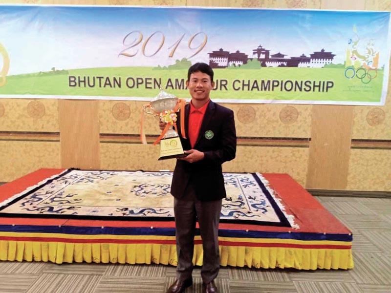 Nepalu0092s Sukra Bahadur Rai holds the trophy after winning the 28th Bhutan Open Amateur Championship at the Royal Thimpu Golf Course in Thimpu on Sunday, October 13, 2019. Photo Courtesy: NGA