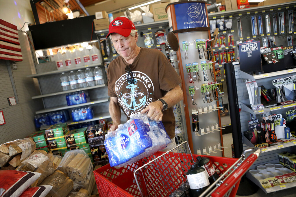 James Cooke is shown buying water bottles along with propane tanks and batteries at a ACE Hardware store as he prepares for a possible power shutdown in Los Gatos, California, US, on Tuesday, October 8, 2019. Millions of people were poised to lose electricity throughout northern and central California after Pacific Gas & Electric Co announced Tuesday it would shut off power in the largest preventive outage in state history to try to avert wildfires caused by faulty lines. Photo: Anda Chu/San Jose Mercury News via AP