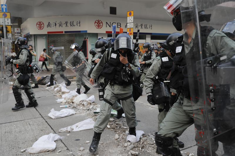 Riot police cross barricade made by protesters during a protest in Hong Kong, Saturday, October 12, 2019. Photo: AP