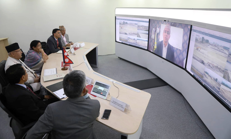Prime Minister KP Sharma Oli along with Cabinet Ministers inspecting the work progress of different infrastructure projects through the u0091action roomu0092 at the Office of Prime Minister and Council of Ministers, in Singha Durbar through video conference on Wednesday, October 23, 2019. Photo: RSS