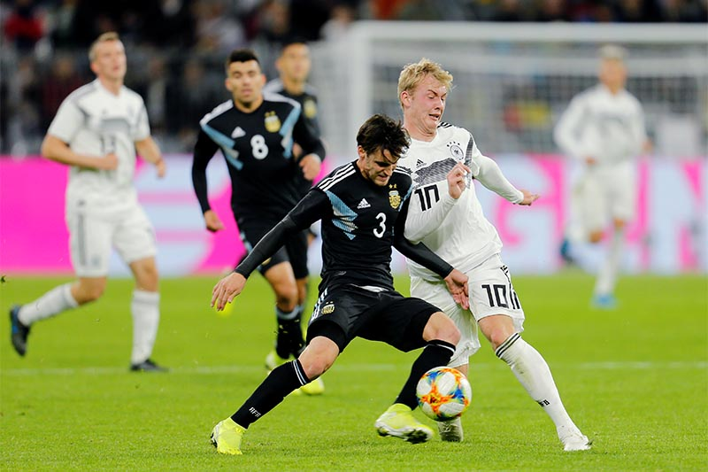 Argentina's Nicolas Tagliafico in action with Germany's Julian Brandt during the international friendly football match between Germany and Argentina at the Signal Iduna Park stadium in Dortmund, Germany, on Wednesday, October 9, 2019. Photo: Reuters