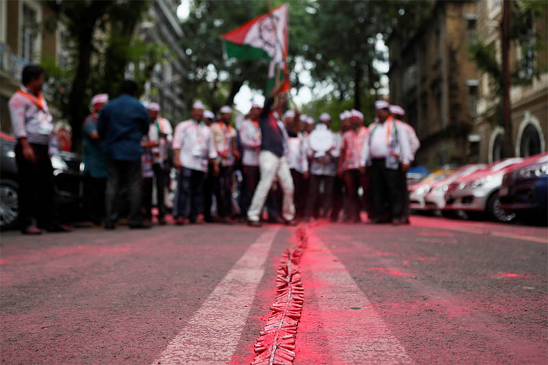 A line of firecrackers is seen outside the Nationalist Congress Party (NCP) office after announcement of initial poll results in Mumbai, India, October 24, 2019. Photo: Reuters
