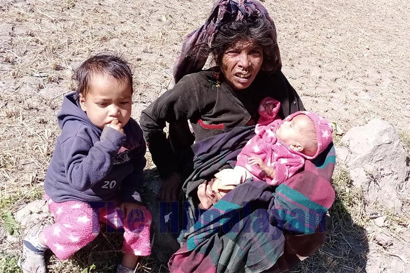 A woman taking care of her grand children, in Sappata area of Swamikartik Rural Municipality-1, Bajura district, on Friday, October 25, 2019. Three-year-old Dev Datta Luwar and his six-month-old sister Basanti Luwar are being brought up by Suki Luwar (51), their only grandmother. Photo: Prakash Singh/THT