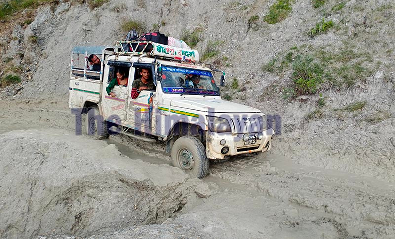 A jeep passing through a rough and muddy road along the Martadi-Kolti road section, in Bajura, on Monday. Photo: THT